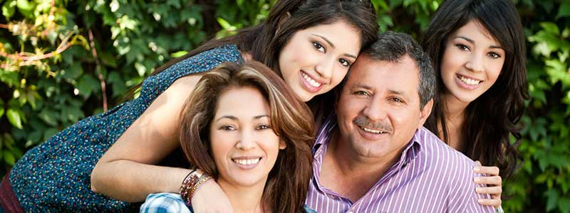 Smiling family after their dental exam