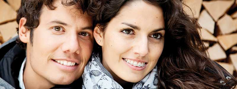 Couple smiling together, the girl is wearing braces
