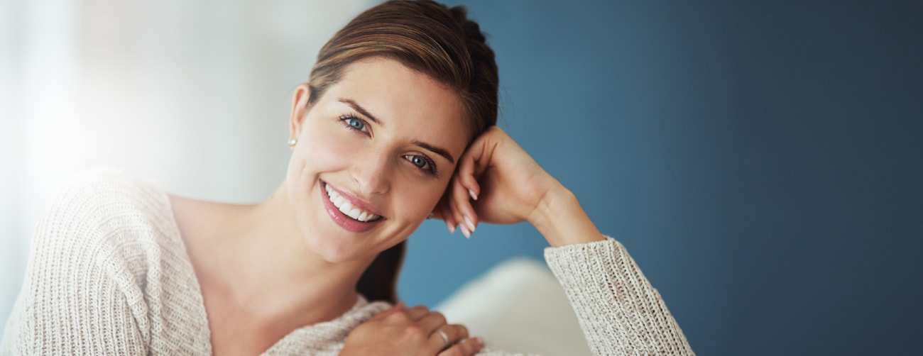 a young woman with a beautiful smile